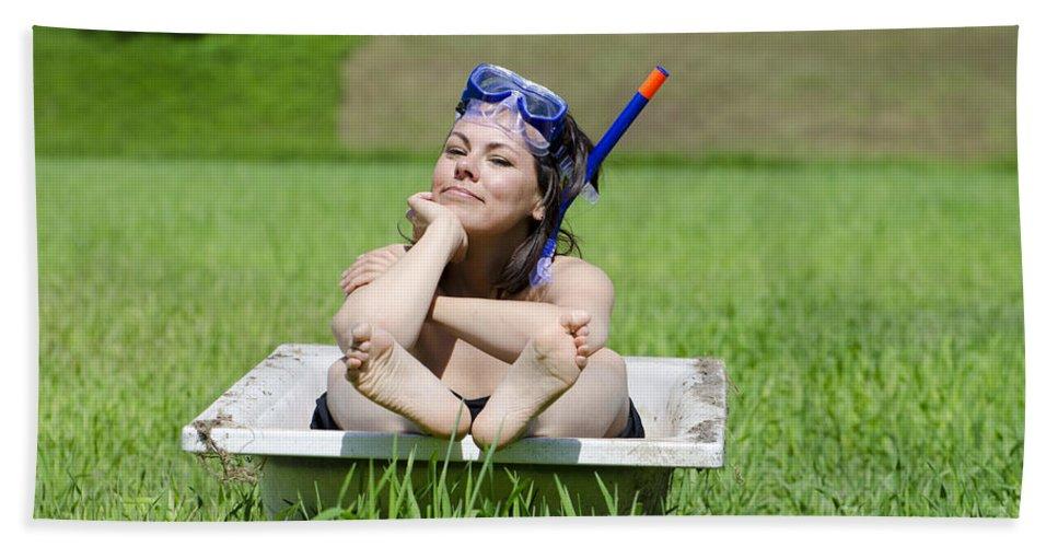 Woman Bath Sheet featuring the photograph Woman Lying In A Bathtub by Mats Silvan