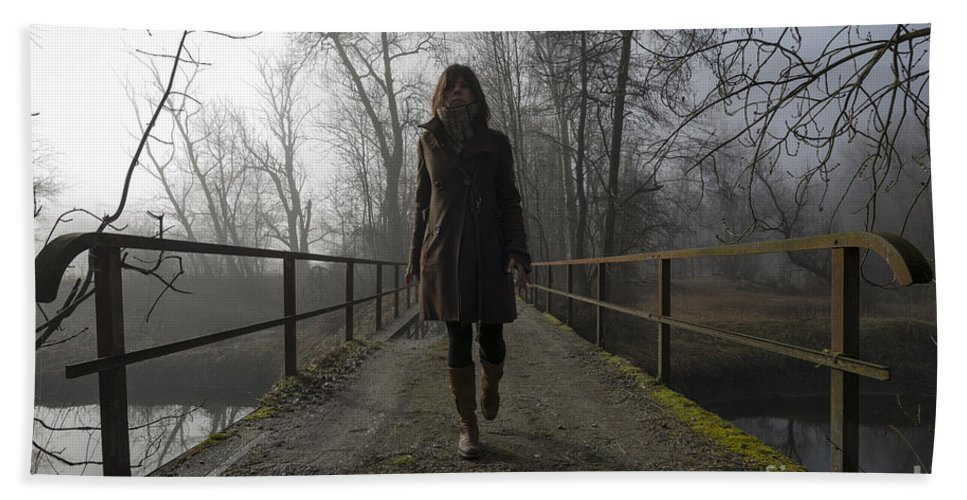 Bridge Bath Sheet featuring the photograph Woman Walking On A Bridge by Mats Silvan