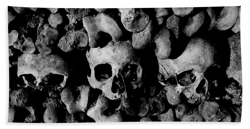 Paris Hand Towel featuring the photograph Skulls And Bones In The Catacombs Of Paris France by Richard Rosenshein