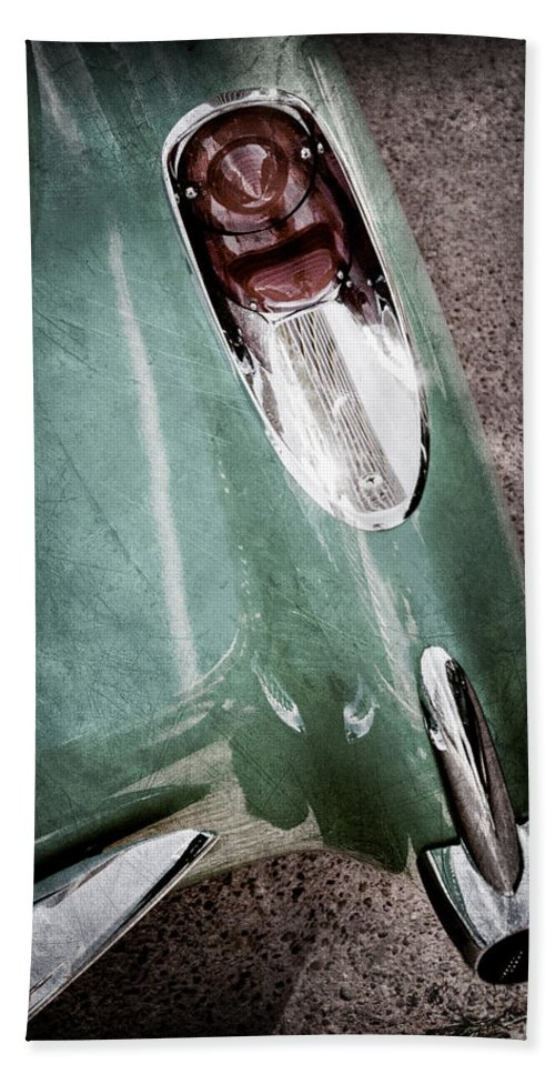1957 Chevrolet Corvette Taillight Hand Towel featuring the photograph 1957 Chevrolet Corvette Taillight by Jill Reger