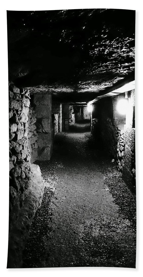 Paris Hand Towel featuring the photograph A Tunnel In The Catacombs Of Paris France by Richard Rosenshein