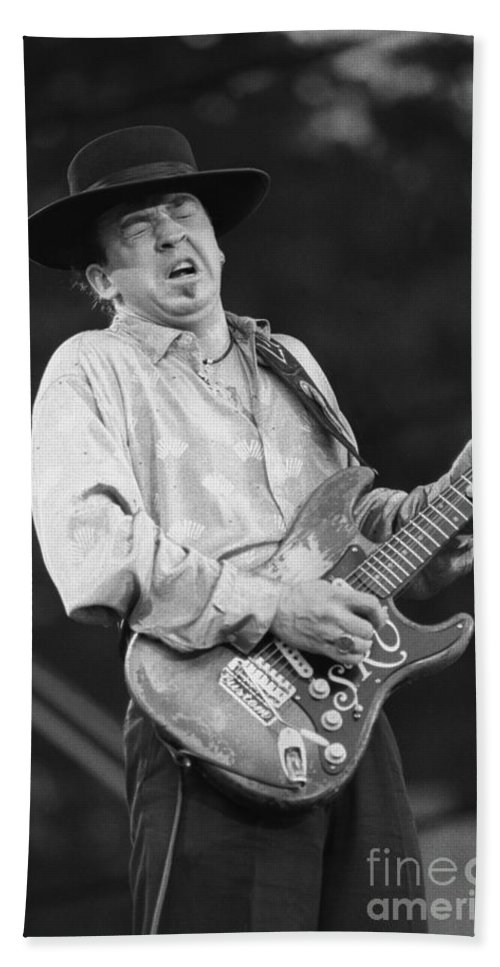 Blues Guitarist Hand Towel featuring the photograph Guitarist Stevie Ray Vaughan by Concert Photos