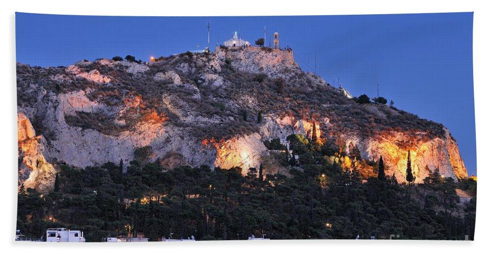Athens; City; Capital; Attica; Attika; Attiki; Greece; Hellas; Greek; Hellenic; Europe; European; Dusk; Twilight; Night; Lights; Holidays; Vacation; Travel; Trip; Voyage; Journey; Tourism; Touristic; Summer; Summertime; Lykavittos; Lykavitos; Lycabettus; Hill; Strefi; View; Houses; Photos; Photograph; Photography Bath Sheet featuring the photograph Lycabettus Hill During Dusk Time by George Atsametakis