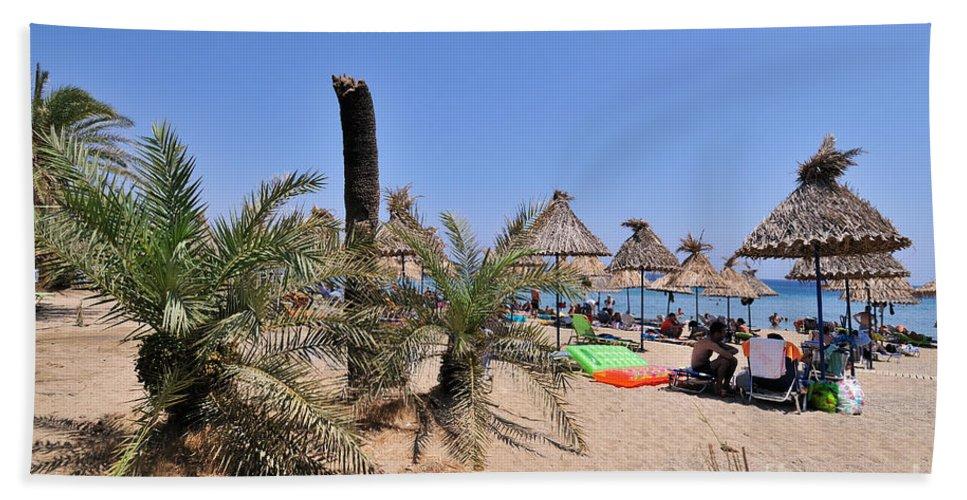 Vai; Lasithi; Lassithi; Beach; Crete; Palms; Trees; Forest; Sand; Kriti; Greece; Hellas; Greek; Hellenic; People; Tourists; Swim; Swimming; Island; Sunbathing; Suntanning; Suntan; Tanning; Relaxing; Relaxation; Sea; Islands; Holidays; Vacation; Travel; Trip; Voyage; Journey; Tourism; Touristic; Summer; Umbrellas; Parasols; Sunshades; Sun Beds; Sea Beds; Blue; Sky Hand Towel featuring the photograph Vai Beach by George Atsametakis