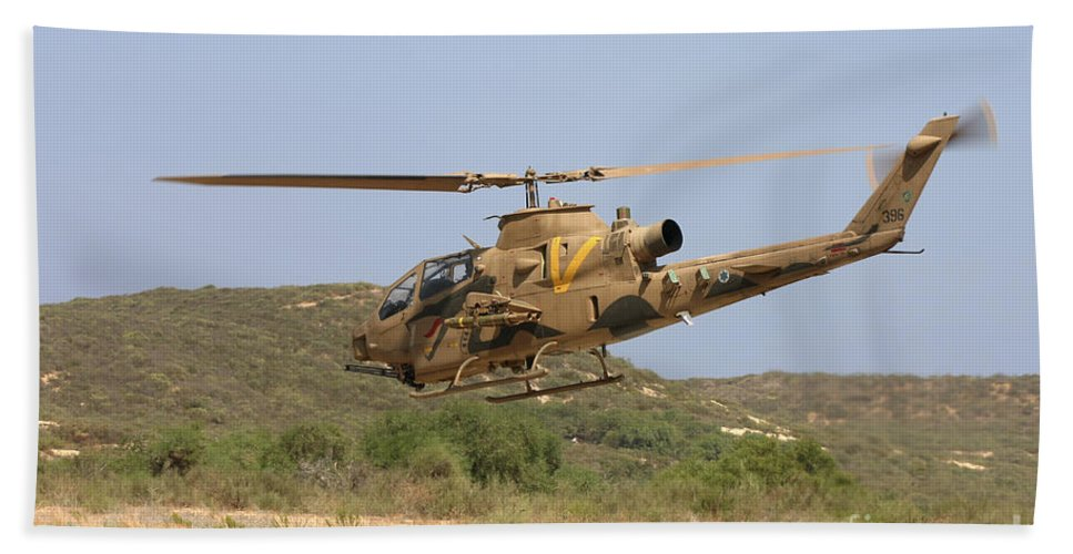 Aircraft Bath Sheet featuring the photograph An Ah-1s Tzefa Attack Helicopter by Ofer Zidon