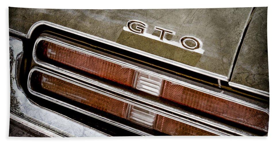 Pontiac Gto Taillight Emblem Hand Towel featuring the photograph 1969 Pontiac Gto Taillight Emblem -0475a by Jill Reger