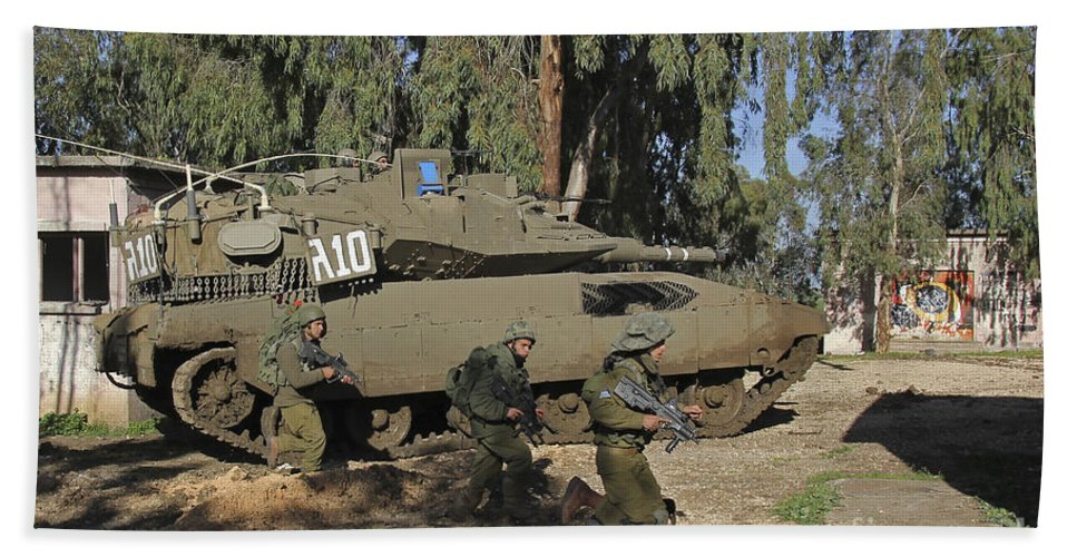 Battletank Hand Towel featuring the photograph An Israel Defense Force Merkava Mark II by Ofer Zidon