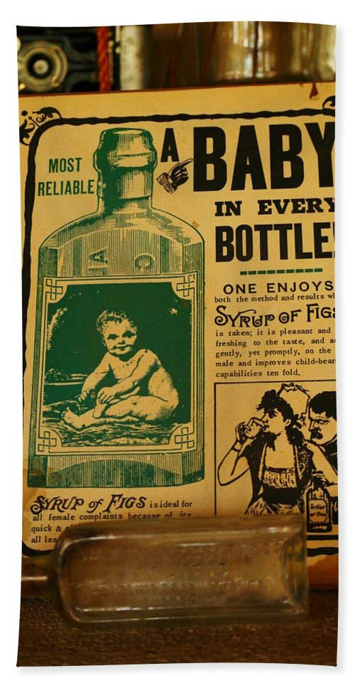 Still Life Hand Towel featuring the photograph A Baby In Every Bottle by Jeff Swan