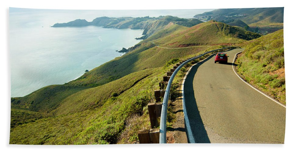 Barrier Hand Towel featuring the photograph A Car Descends Conzelman Road by Jeff Diener