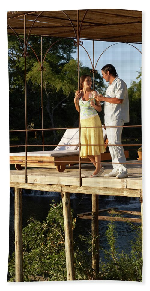 Balcony Hand Towel featuring the photograph A Couple Having Drinks On A Deck by Tom Hopkins