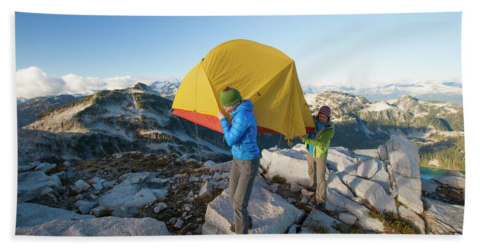 British Columbia Hand Towel featuring the photograph A Couple Of Backpackers Carry by Christopher Kimmel
