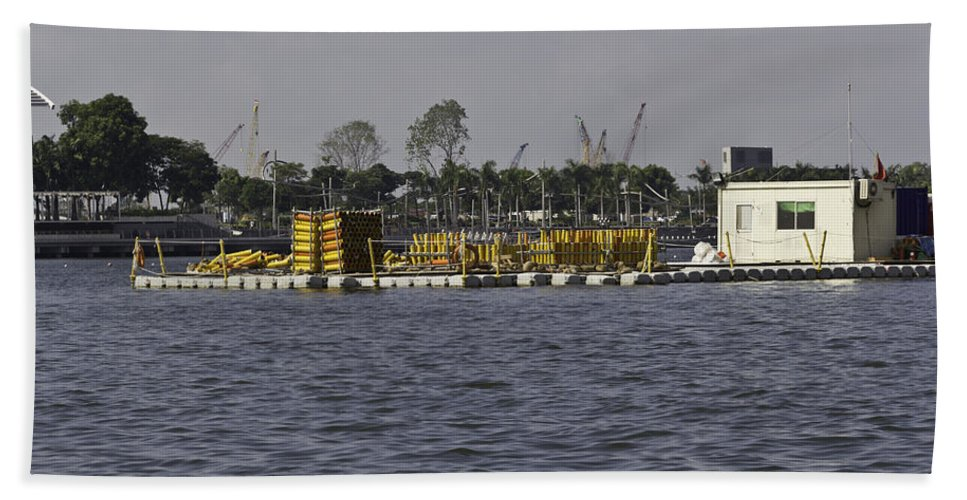 Building Bath Sheet featuring the photograph A Floating Platform With A Number Of Pipes Used For Construction by Ashish Agarwal
