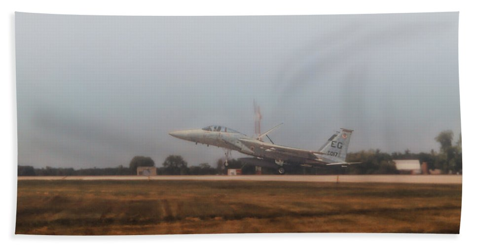 Mcdonnell Douglas F-15 Eagle Bath Sheet featuring the photograph A Foggy Landing by Tommy Anderson