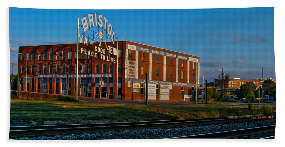 Bristol Tn Tennessee Va Virginia Train Tracks Dusk Historic Sign State Street Interstate Hardware Company Golden Hour Bath Sheet featuring the photograph A Good Place To Live by Karl Greeson