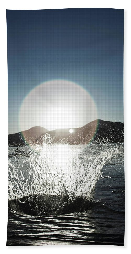 Action Hand Towel featuring the photograph A Happy Young Women Canon Balls by Patrick Orton
