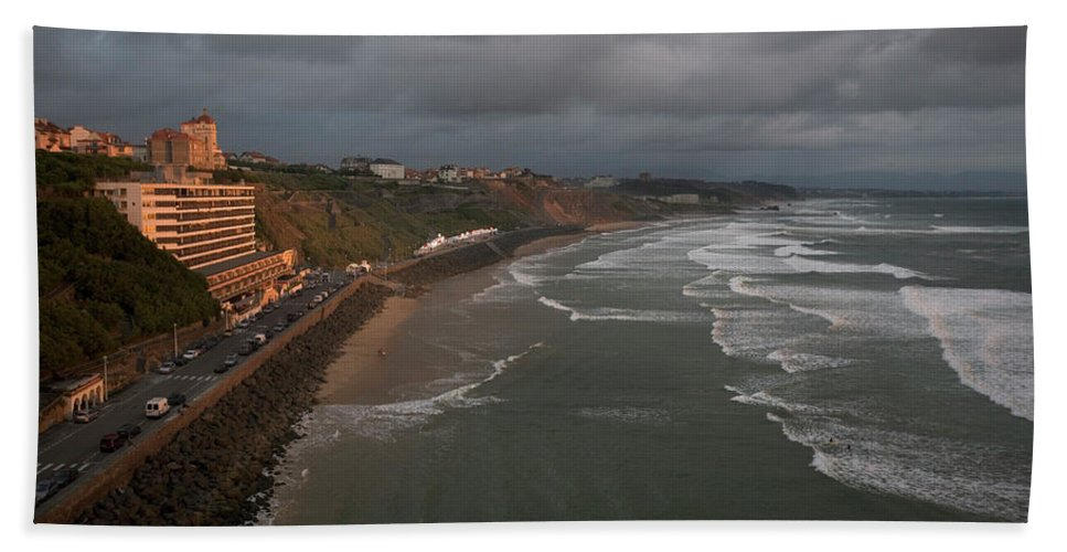 Atlantic Ocean Hand Towel featuring the photograph A Hotel Lit By A Pinkish Orange Sunset by Aaron Black