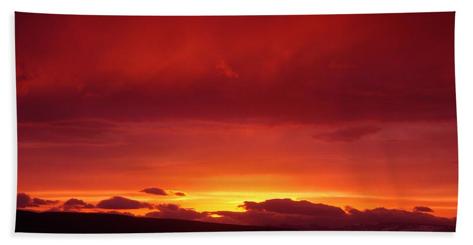 Sunset Bath Sheet featuring the photograph A Light In The Clouds by Jeff Swan