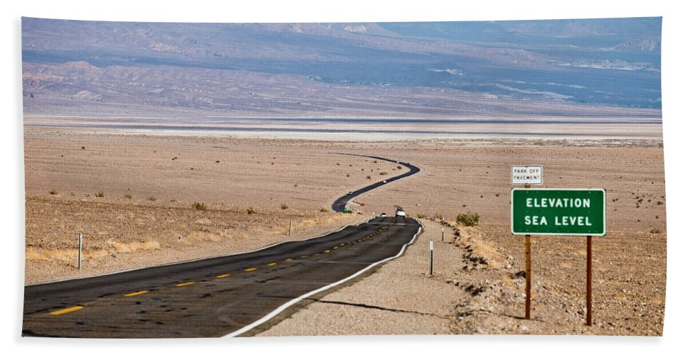 Arid Hand Towel featuring the photograph A Long Road Through Death Valley by Rob Hammer