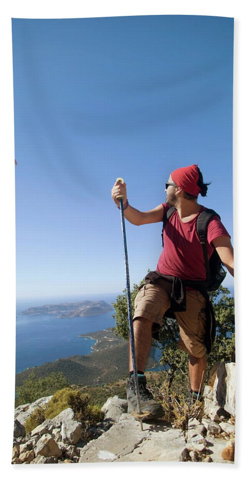Antalya Hand Towel featuring the photograph A Male Climber Looking At Paragliding by Me Studio
