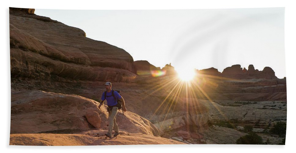 45-49 Years Hand Towel featuring the photograph A Man Hiking In The Needles District by Kennan Harvey