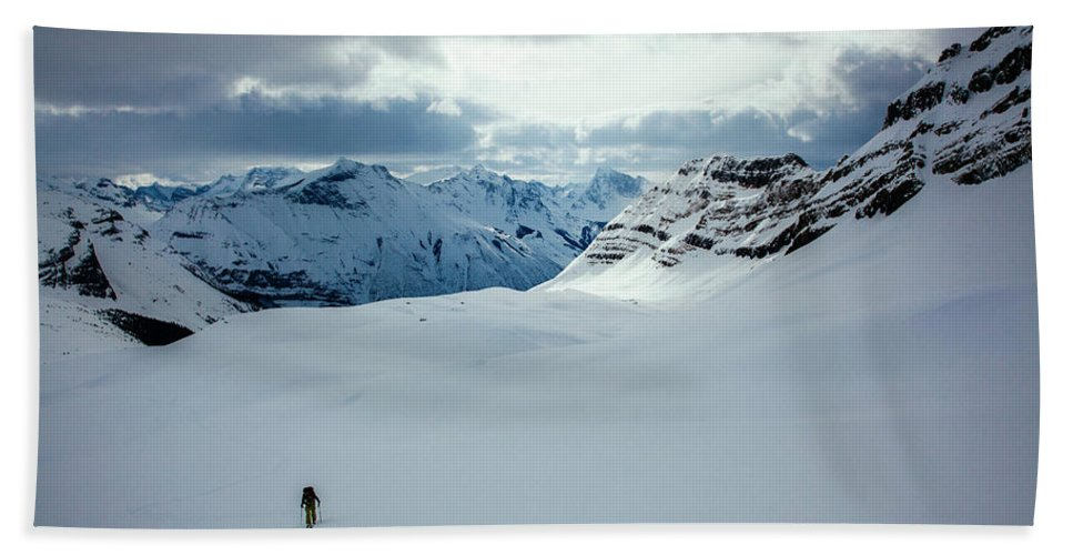 Cold Temperature Hand Towel featuring the photograph A Man Ski Touring Near Icefall Lodge by Mike Schirf