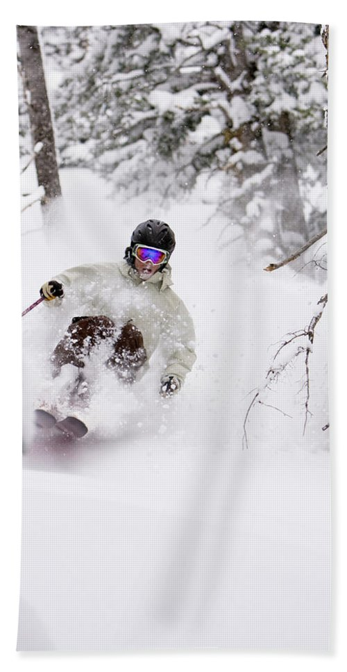 20s Hand Towel featuring the photograph A Man Skiing Powder In The Trees by Mike Schirf