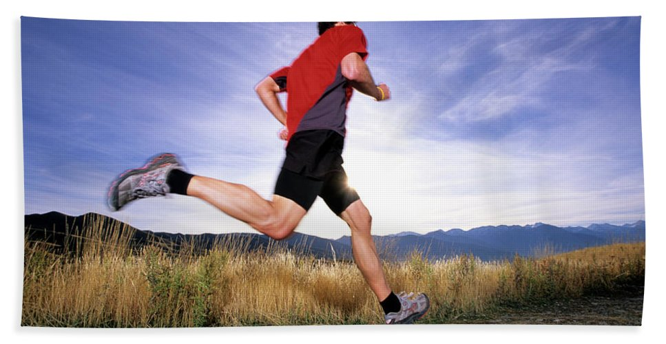 Action Hand Towel featuring the photograph A Man Trail Runs In Salt Lake City by Scott Markewitz