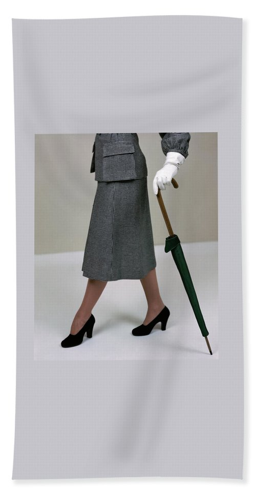 Accessories Bath Towel featuring the photograph A Model Holding An Umbrella by Serge Balkin