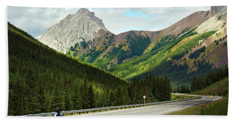 Alberta Bath Sheet featuring the photograph A Motorcyclist Enjoys An Open Stretch by Todd Korol