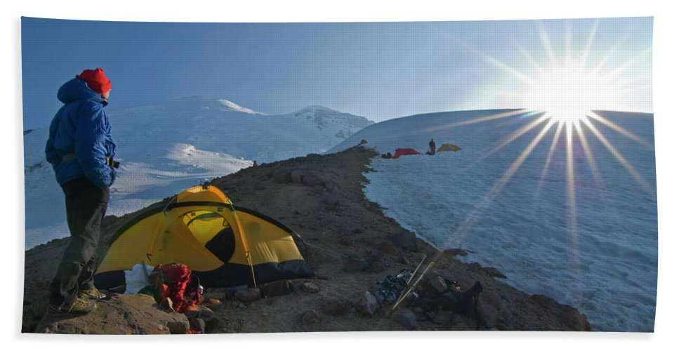 Adult Hand Towel featuring the photograph A Mountaineer Contemplates The Sun by Cliff Leight