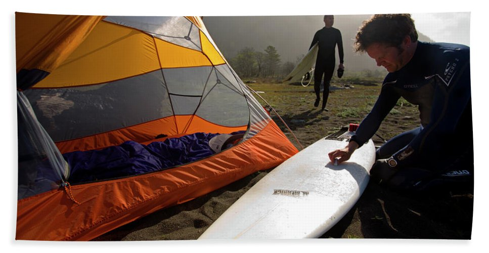 Athlete Hand Towel featuring the photograph A Pair Of Surfers Prepare To Surf by Corey Rich