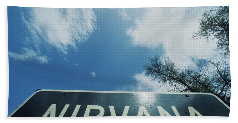 Photography Bath Sheet featuring the photograph A Sign That Reads Nirvana by Panoramic Images