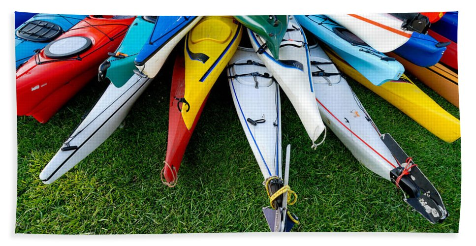 A Lot Hand Towel featuring the photograph A Stack Of Kayaks by Amy Cicconi