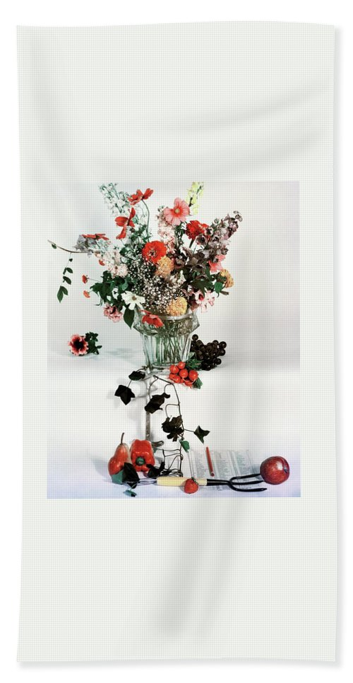 Nobody Bath Towel featuring the photograph A Studio Shot Of A Vase Of Flowers And A Garden by Herbert Matter
