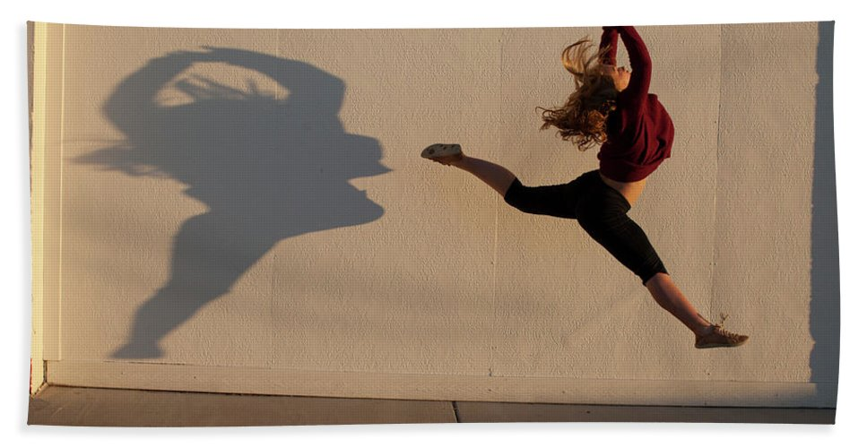 Blonde Hair Hand Towel featuring the photograph A Teenage Girl Playing With Her Shadow by Woods Wheatcroft