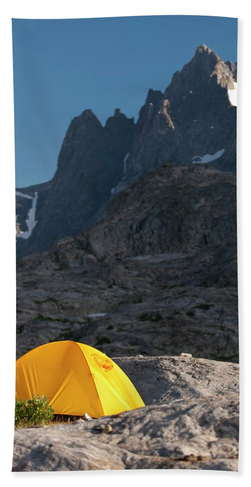 Adventure Hand Towel featuring the photograph A Tent Is Dwarfed By The High Peaks by Jeff Diener