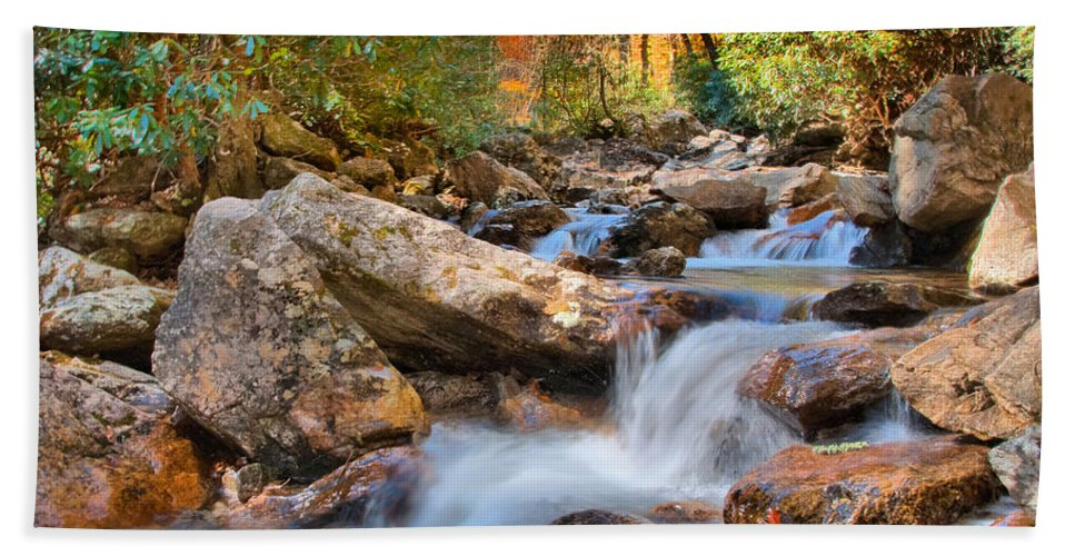 Appalacia Bath Towel featuring the photograph A Touch Of Autumn At Skinny Dip Falls by Lynn Bauer