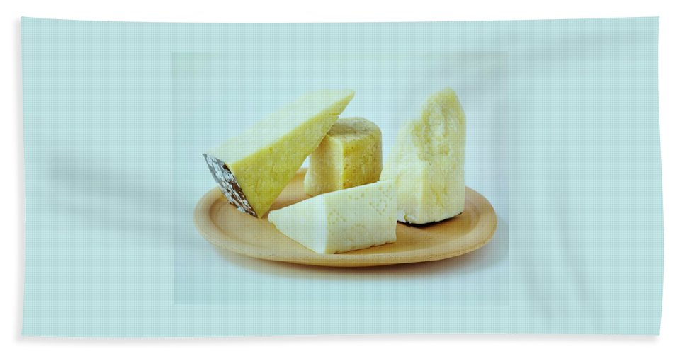 Dairy Bath Towel featuring the photograph A Variety Of Cheese On A Plate by Romulo Yanes