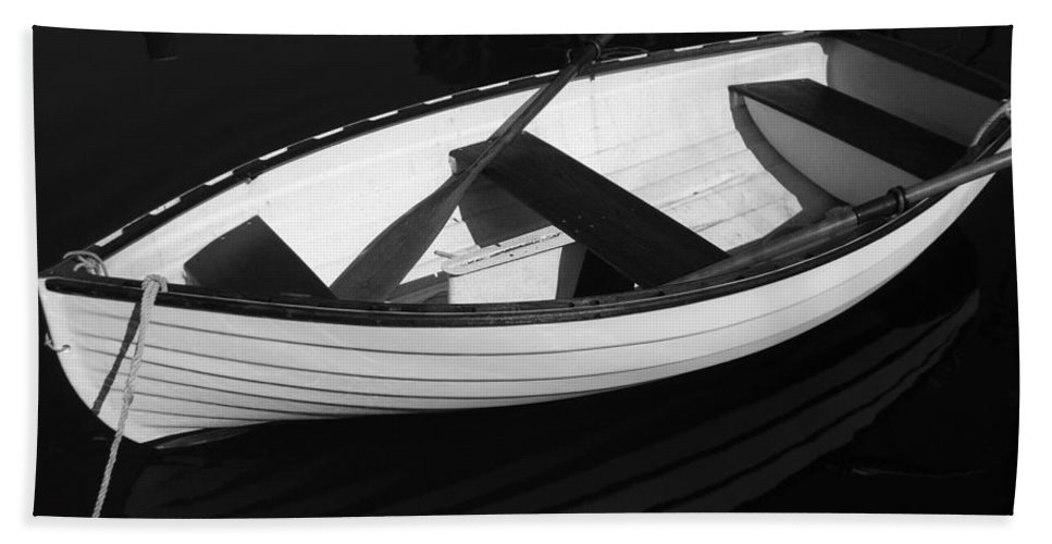 Boats Bath Sheet featuring the photograph A White Rowboat by Xueling Zou