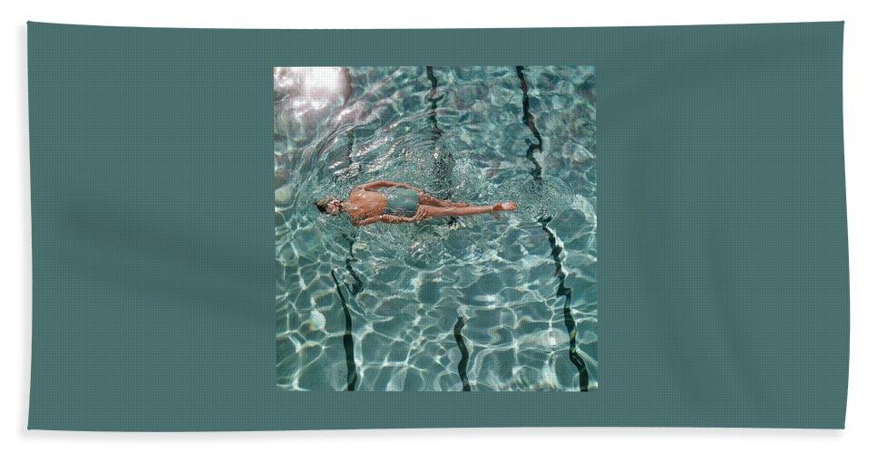 A Woman Swimming In A Pool Bath Towel