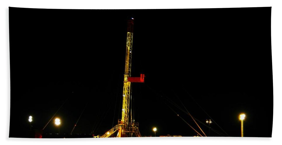 Oil Rigs Hand Towel featuring the photograph A Workover Rig At Night by Jeff Swan