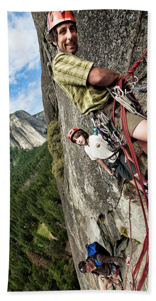 10-11 Years Hand Towel featuring the photograph A Young Boy And Climbers In Yosemite by Kevin Steele