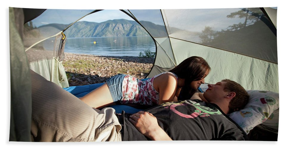 20-24 Years Hand Towel featuring the photograph A Young Couple Camping Talk by Patrick Orton