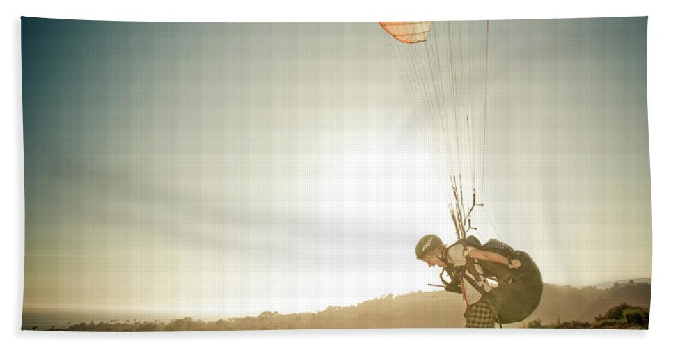 Adult Bath Sheet featuring the photograph A Young Man Launches His Paraglider by Kevin Steele