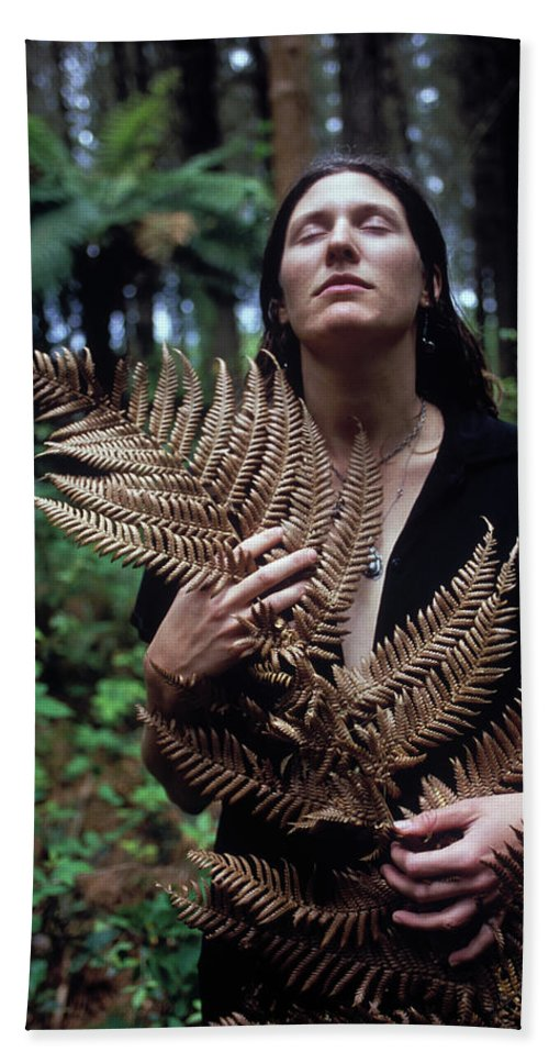 Calm Bath Sheet featuring the photograph A Young Woman Cradles A Fern Frond by Kyle George