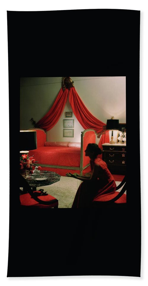 One Person Bath Towel featuring the photograph A Young Woman Sitting In A Red Bedroom by Horst P. Horst