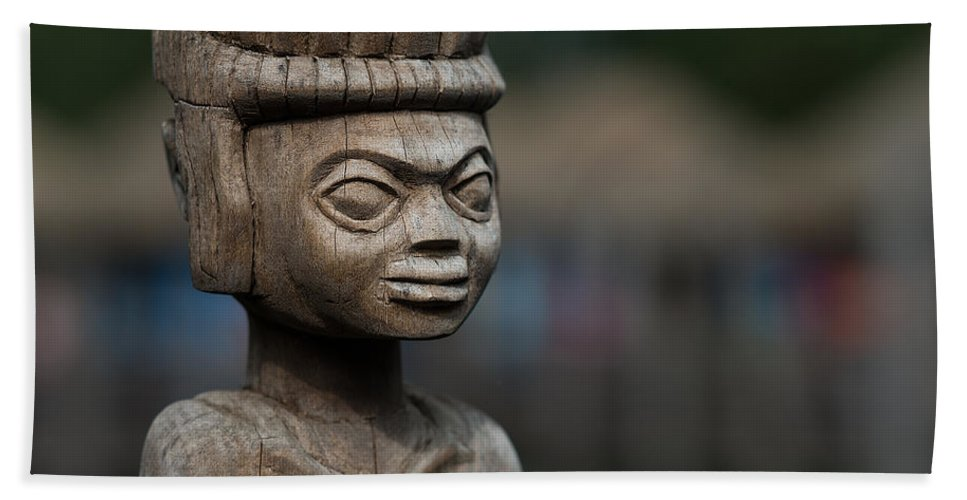 African Hand Towel featuring the photograph African Aging Wooden Sculpture by TouTouke A Y