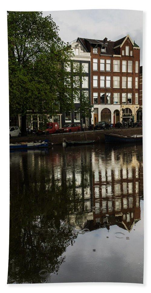 Amsterdam Bath Sheet featuring the photograph Amsterdam Canal Houses In The Rain by Georgia Mizuleva
