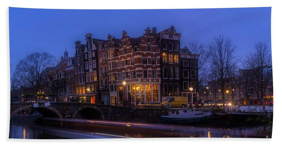 Amsterdam Corner Cafe Hand Towel featuring the photograph Amsterdam Corner Cafe With Light Trails by Ann Garrett