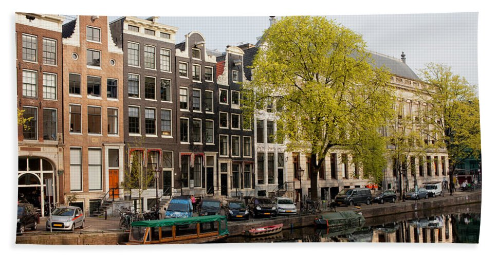 Amsterdam Hand Towel featuring the photograph Amsterdam Houses Along The Singel Canal by Artur Bogacki